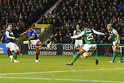 Alfredo Morelos' shot is blocked by Efe Ambrose during the Ladbrokes Scottish Premiership match between Hibernian and Rangers at Easter Road, Edinburgh, Scotland on 19 December 2018.