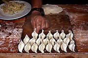 Preparing dumplings for dinner, Dali.