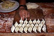 Preparing dumplings for dinner, Dali.