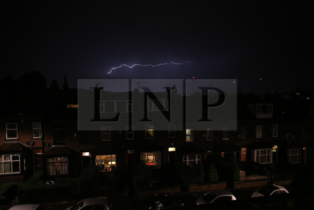 © Licensed to London News Pictures. 13/07/2016. Leeds, UK. Lightening strikes during a dramatic storm in Leeds, West Yorkshire, this evening. Today temperatures reached the highest they have been in the UK during September since 1911. Photo credit : Ian Hinchliffe/LNP