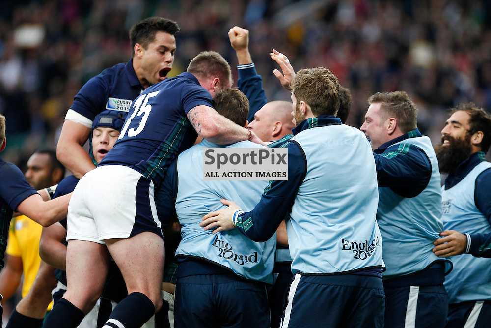 TWICKENHAM, ENGLAND - OCTOBER 18:  Scotland celebrate Peter Horne's try during the 2015 Rugby World Cup quarter final between Scotland and Australia at Twickenham Stadium on October 18, 2015 in London, England. (Credit: SAM TODD | SportPix.org.uk)