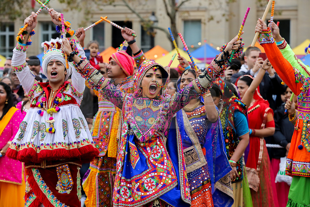 © Licensed to London News Pictures. 03/11/2019. London, UK. Dancers in colourful costumes perform a traditional Indian dance in Trafalgar Square to celebrate Diwali - the festival of light. Hundreds of Hindus, Sikhs, Jains and people from all communities attend Diwali celebrations in London's Trafalgar Square. Diwali s celebrated each year with a free concert of traditional, religious and contemporary Asian music and dance. Photo credit: Dinendra Haria/LNP