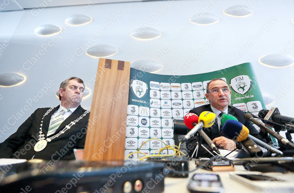 Irish Soccer Boss Martin O Neill pictured at the Press Conference at Limericks County Hall, Dooradoyle in Limerick City, as Cllr John Sheahan, Cathaoirleach of Limerick County Council listens ho the manager  announce his squad for the upcoming friendly game versus Serbia, in the presence of the Mayor and the Limerick County Council and the County Manager.<br /> Pic. Brian Arthur/ Press 22.