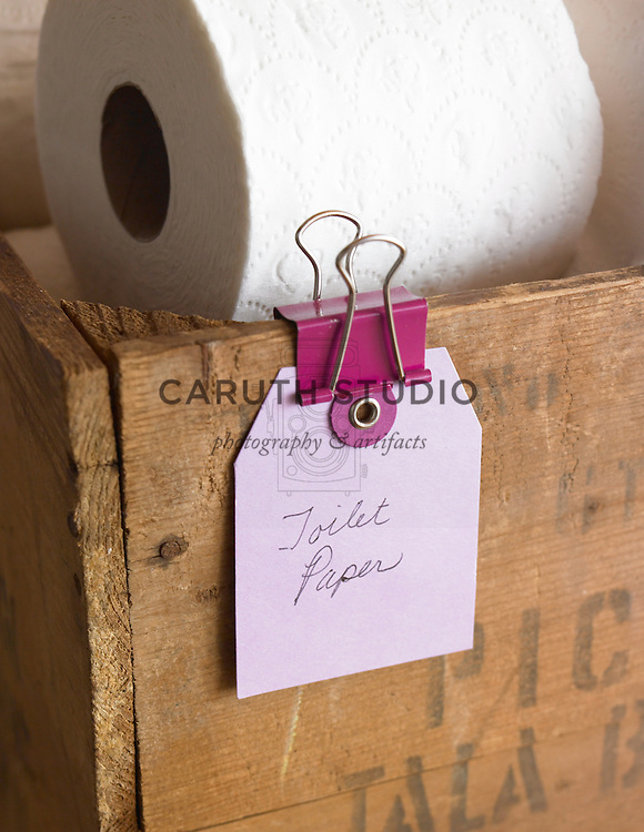 Labeled bathroom tissue storage in vintage crate