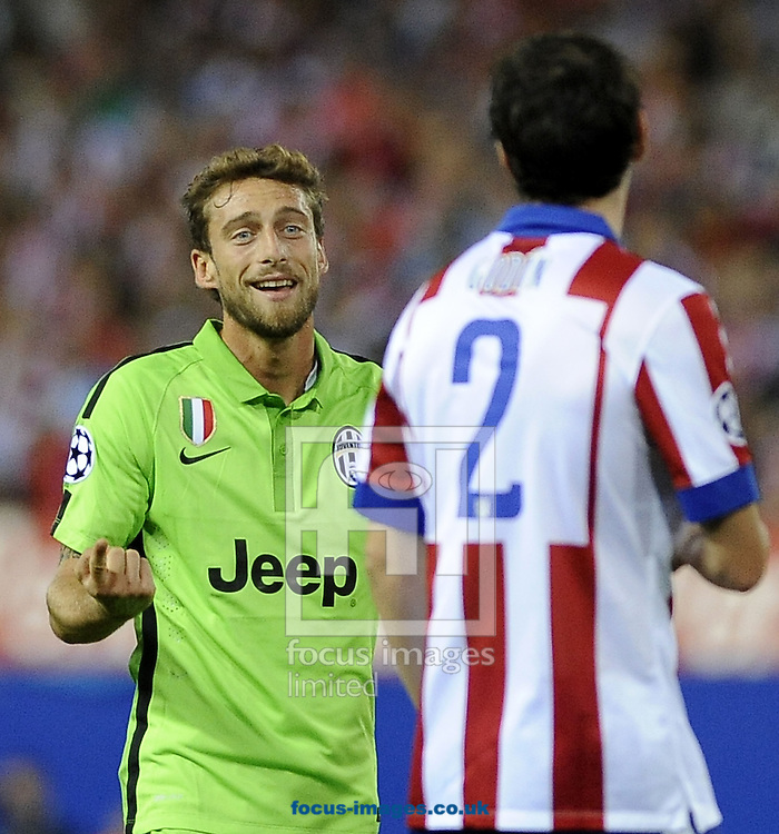 Diego God&iacute;n of Atletico Madrid and Claudio Marchisio of Juventus during the UEFA Champions League match at Vicente Calder&oacute;n Stadium, Madrid<br /> Picture by Stefano Gnech/Focus Images Ltd +39 333 1641678<br /> 01/10/2014