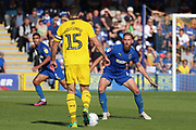 AFC Wimbledon midfielder Scott Wagstaff (7) waiting to tackle Oxford United defender John Mousinho (15) during the EFL Sky Bet League 1 match between AFC Wimbledon and Oxford United at the Cherry Red Records Stadium, Kingston, England on 29 September 2018.