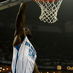 April 3, 2011; New Orleans, LA, USA; New Orleans Hornets center Emeka Okafor (50) dunks against the Indiana Pacers during the first quarter at the New Orleans Arena.    Mandatory Credit: Derick E. Hingle
