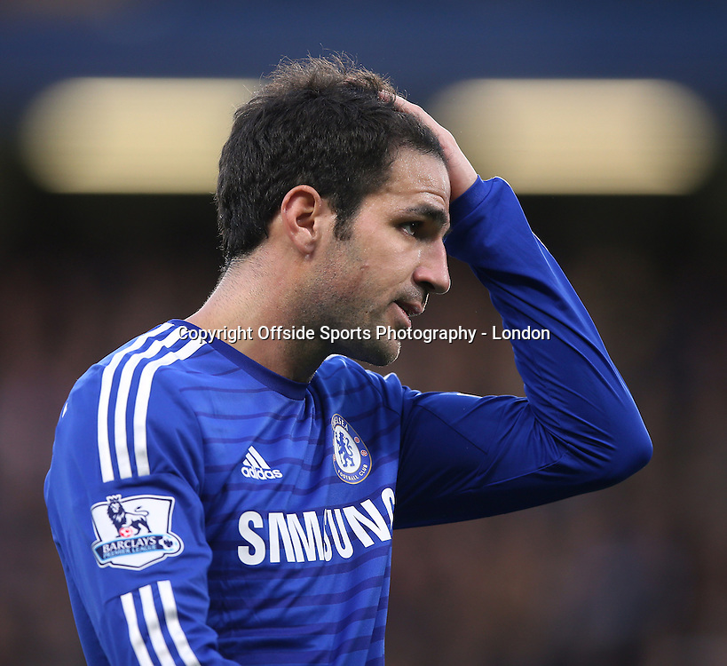 10 January 2015 Premier League Football - Chelsea v Newcastle United ;  Cesc Fabregas holds his head.<br /> Photo: Mark Leech