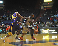 "Ole Miss forward Terrance Henry (1) drives the lane as Louisiana State's Storm Warren (24) defends at the C.M. ""Tad"" Smith Coliseum in Oxford, Miss. on Wednesday, February 9, 2011. Ole Miss won 66-60 and is now 4-5 in the Southeastern Conference."