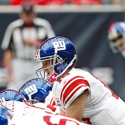 October 10, 2010; Houston, TX USA; New York Giants quarterback Eli Manning (10) under center against the Houston Texans at Reliant Stadium. Mandatory Credit: Derick E. Hingle
