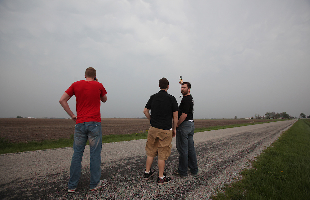 Ball State storm chasers including (left to right) Sam Abbott, Jessie Hawila, and Lucas Reese take a reading as a storm approaches in southern Illinois Tuesday April 19. The storm system produced multiple tornados and large hail.