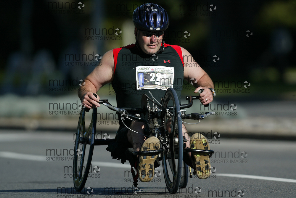 "(Ottawa, Ontario -- 20 Sep 2009) A bicycle chair athlete racing in the Army Run half-marathon in Ottawa. [Photo credit should read ""Sean Burges / Mundo Sport Images""]"