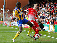 Nathan Clarke of Leyton Orient and Clayton Donaldson of Brentford during the Sky Bet League 1 match at the Matchroom Stadium, London<br /> Picture by Mark D Fuller/Focus Images Ltd +44 7774 216216<br /> 15/03/2014
