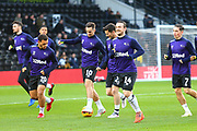 Derby County forward Jack Marriott (14) and the Rams players warm up during the EFL Sky Bet Championship match between Derby County and Aston Villa at the Pride Park, Derby, England on 10 November 2018.