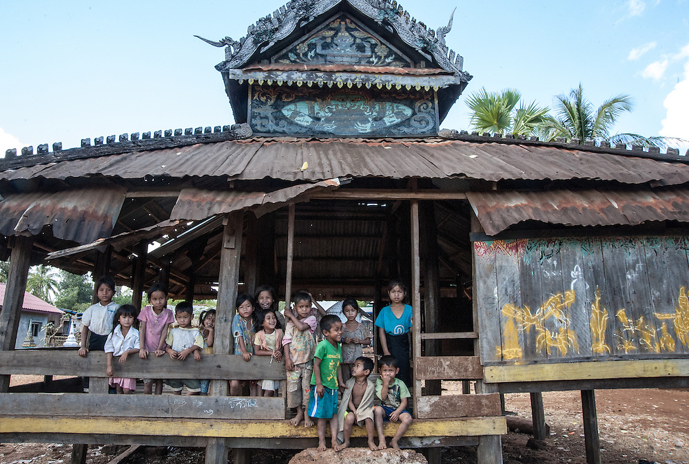 Kids hanging out at the village temple on the Bolaven Plateau, Laos