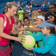 August 23, 2014, New Haven, CT:<br /> Petra Kvitova signs autographs after winning the singles final against Magdalena Rybarikova on day nine of the 2014 Connecticut Open at the Yale University Tennis Center in New Haven, Connecticut Saturday, August 23, 2014.<br /> (Photo by Billie Weiss/Connecticut Open)