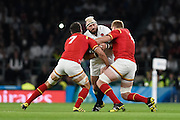 England prop Joe Marler is tackled by Wales back row Sam Warburton andWales lock Bradley Davies during the Rugby World Cup Pool A match between England and Wales at Twickenham, Richmond, United Kingdom on 26 September 2015. Photo by David Charbit.