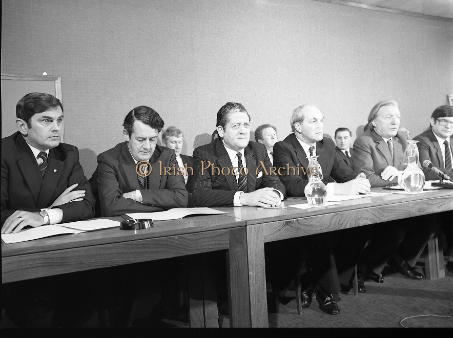 Fianna Fáil Front Bench at Press Conference January 1982..1982-01-14.14th January 1982..14/01/1982.01.14.82...Charles Haughey presents his front bench to the waiting media..Pictured at Leinster House..Front row From Left: ..Ray McSharry TD: Spokesman on Fisheries..Des O'Malley TD:.Spokeman on Industry and Commerce..Brian Lenihan TD:..George Colley TD: Deputy Leader and Spokesman on Energy..Charles Haughey TD: Leader of the Opposition..Ray Burke TD: Leader of the House ..Back Row from Left:..First - Sean Doherty