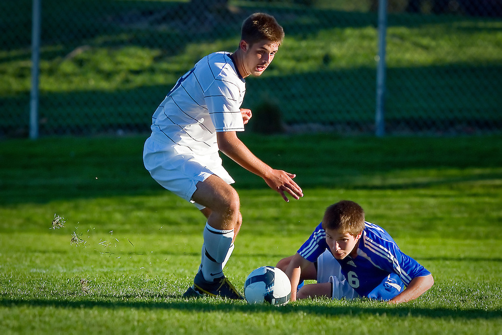 Lake City High's T.J. Merwin turns upfield to get to a ball after Kevin Hampson from Coeur d'Alene High lost his footing.