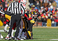 November 23 2012: Iowa Hawkeyes cornerback Micah Hyde (18) comes up with the ball after a fumbled punt return by Nebraska during the first half of the NCAA football game between the Nebraska Cornhuskers and the Iowa Hawkeyes at Kinnick Stadium in Iowa City, Iowa on Friday November 23, 2012. Nebraska defeated Iowa 13-7 in the Heroes Game on Black Friday.