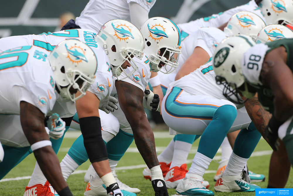 The Miami Dolphins offensive line in action during the New York Jets Vs Miami Dolphins  NFL American Football game at MetLife Stadium, East Rutherford, NJ, USA. 1st December 2013. Photo Tim Clayton