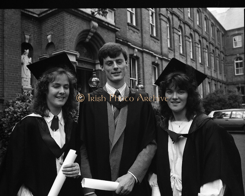 Graduations At Carysfort College.  (R84)..1988..24.07.1988..07.24.1988..24th July 1988..Today at Carysfort College saw the final conferring of degrees on the students in the teacher training programme. The college in Blackrock, Dublin trains students to become primary school teachers after a three year course and is under the control of the Department of Education...Image shows Cailin ni Ghairbhi, Ventry, Co Kerry, Terence Dineen, Ballyheigue, Co Kerry and Marie Ni Fhlatharta, Ventry, Co Kerry after the conferring ceremony.