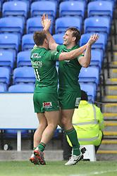 London Irish Full Back (#15) Andrew Fenby celebrates his try with London Irish Winger (#11) Alex Lewington - Photo mandatory by-line: Dougie Allward/JMP - Mobile: 07966 386802 - 12/04/2015 - SPORT - Rugby - Reading - Madejski Stadium - London Irish v Sale Sharks - Aviva Premiership