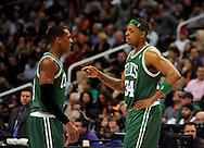 Jan. 28, 2011; Phoenix, AZ, USA; Boston Celtics guard Rajon Rondo (9) and teammate forward Paul Pierce (34) react on the court against the Phoenix Suns at the US Airways Center.  The Suns defeated the Celtics 88-71. Mandatory Credit: Jennifer Stewart-US PRESSWIRE