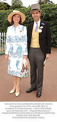 VISCOUNT & VISCOUNTESS MACKINTOSH OF HALIFAX at Royal Ascot on 19th June 2003.PKR 13