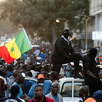Senegalese private security officers for opposition party leaders watch over a crowd during a protest in Dakar, Senegal, 21 February 2012. Violent demonstrations against incumbent President Abdoulaye Wade's re-election bid continue in the capital Dakar ahead of presidential elections. Protesters are demonstrating against a ruling by the country's top judges allowing President Abdoulaye Wade to seek a third term in office. Presidential elections are scheduled for 26 February 2012. © Sylvain Cherkaoui
