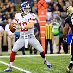 Nov 1, 2015; New Orleans, LA, USA; New York Giants quarterback Eli Manning (10) is pressured by New Orleans Saints inside linebacker Ramon Humber (53) during the first quarter of a game at the Mercedes-Benz Superdome. Mandatory Credit: Derick E. Hingle-USA TODAY Sports