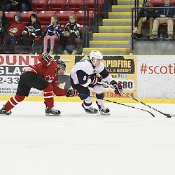 WELLINGTON, - Dec 11, 2015 -  Exhibition Game 2- Team USA vs Team Canada East at the 2015 World Junior A Challenge at the Wellington District Community Centre, ON. Derek Topatigh #6 of Team Canada East tries to keep the puck from Max Zimmer #6 of Team United States during the first period.<br /> (Photo: Andy Corneau / OJHL Images)