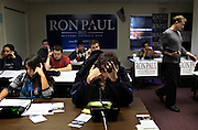 A room full of volunteers call potential voters at Ron Paul's Concord headquarters. Seventeen staffers and scores of volunteers  worked at the Hall Street office as Paul and other candidates work to sway voters one day before the New Hampshire primary; Monday, January 9, 2012. <br /> <br /> (Alexander Cohn/ Monitor staff)