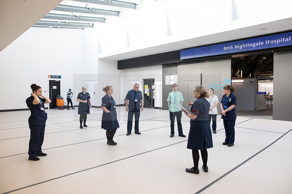 © Licensed to London News Pictures. 13/04/2020. Manchester, UK. The first group of nurses to work at the hospital are given a tour of the first completed ward . The National Health Service has builta 648 bed field hospital for the treatment of Covid-19 patients , at the historical railway station terminus which now forms the main hall of the Manchester Central Convention Centre . The facility is due to open this week (commencing Easter Monday , 13th April 2020 ) and will treat patients from across the North West of England , providing them with general medical care and oxygen therapy after discharge from Intensive Care Units . Photo credit: Joel Goodman/LNP