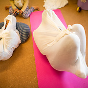 "TOKYO, JAPAN - JANUARY 29 : Participants wrapped in a white cloth during a workshop called ""Otonamaki"", which directly translates to adult wrapping, Tokyo, Japan on Sunday, January 29, 2017. Otonamaki is a Japanese therapeutic method meant to alleviate posture problems and stiffness. (Photo by Richard Atrero de Guzman/ANADOLU Agency)"