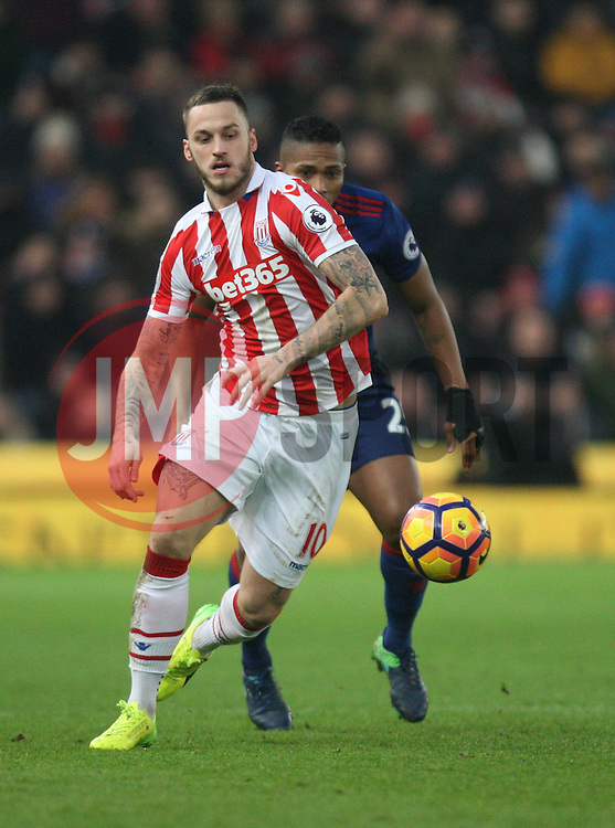 Marko Arnautovic of Stoke City (L) and Luis Antonio Valencia of Manchester United in action - Mandatory by-line: Jack Phillips/JMP - 21/01/2017 - FOOTBALL - Bet365 Stadium - Stoke-on-Trent, England - Stoke City v Manchester United - Premier League