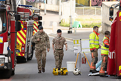 © Licensed to London News Pictures . 18/04/2018. Manchester, UK. Soldiers from the Royal Logistics Corps at the scene. Buildings are evacuated and streets closed off by police amid reports of a chemical spill at a building belonging to the Manchester Institute of Biotechnology on Princess Street in Manchester City Centre . Photo credit : Joel Goodman/LNP