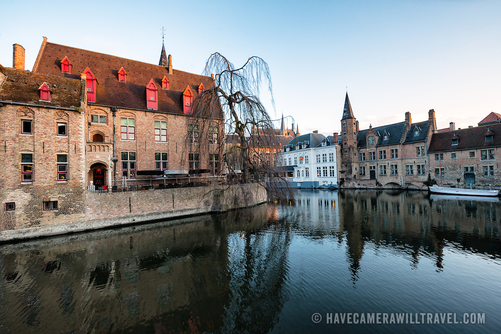 """Sometimes called """"The Venice of the North,"""" the historic Flemish city of Bruges has canals running through the old town. Before the water access became silted up, Bruges was a major commercial port. The building in the foreground at left is known as Perez de Malvenda, the 15th century mayor's house."""