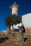 Turkey, Antalya Province, Olympos National Park, Cape Gelidonya. The lighthouse Female backpacker