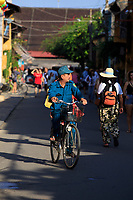 A cyclist on the streets of the old town of Hoi An, Vietnam