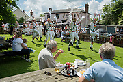 Thaxted Morris Weekend 3-4 June 2017<br />A meeting of member clubs of the Morris Ring celebrating the 90th anniversary of the founding of the Thaxted Morris Dancing side or team in Thaxted, North West Essex, England UK. <br />Cambridge Morris dancing side perform at the Horse and Groom pub, Cornish Hall End, Essex.<br />Hundred of Morris dancers from the UK and this year the Silkeborg side from Denmark spend most of Saturday dance outside pubs in nearby villages where much beer is consumed. In the late afternoon all the sides congregate in Thaxted where massed dancing is perfomed along Town Street. As darkness falls across Thaxted the spell binding Abbots Bromley Horn Dance is performed to the sound of a solo violin in the dark.