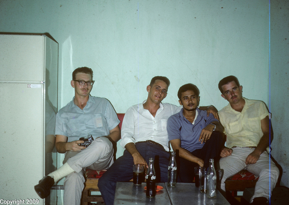 Four American servicement pose for a photo during the Vietnam War. This images is from the collection of J.W. Womble of the 610th Transportation Company during the Vietnam War.