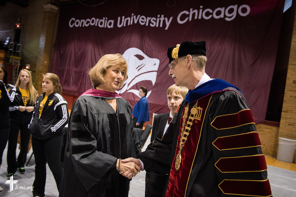 Margaret Trybus, EdD, Professor of Educational Leadership, greets the Rev. Dr. Daniel Lee Gard, president of Concordia University Chicago, during a reception following Gard's inauguration convocation at the college in River Forest, Ill., on Friday, Oct. 10, 2014. LCMS Communications/Erik M. Lunsford