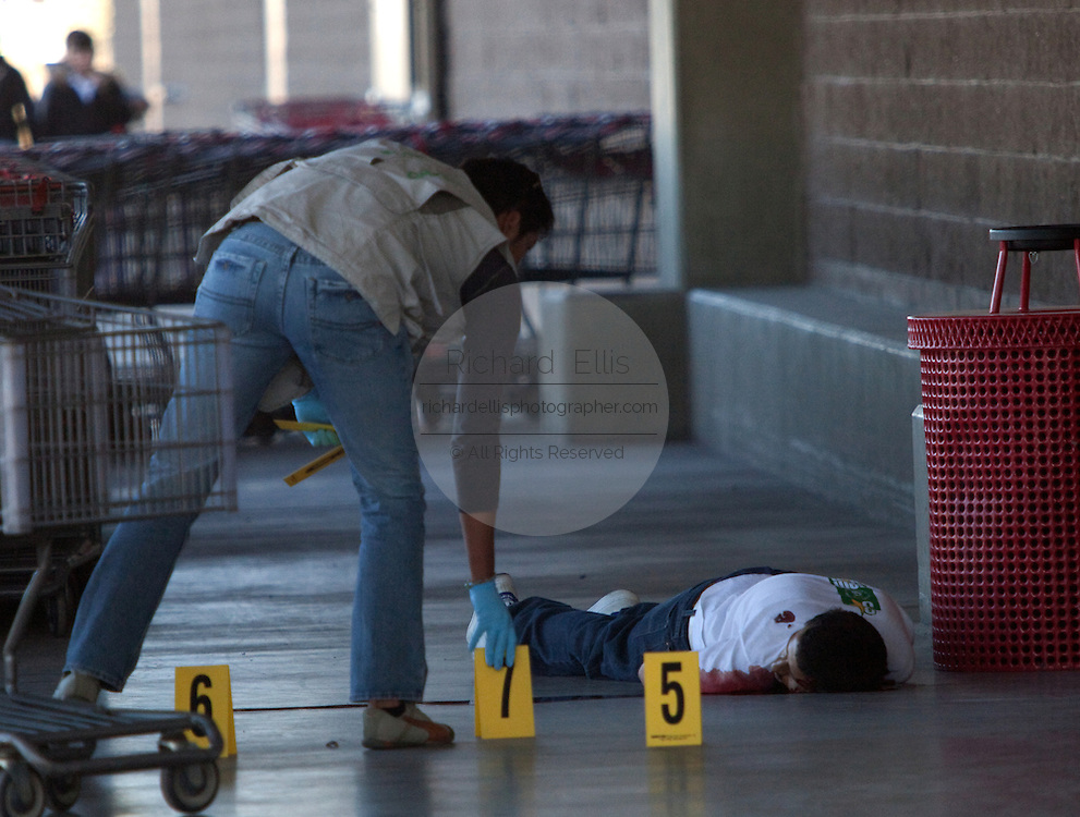 Investigators number the bullet casings found at the scene of a drug related execution at the Costco in Juarez, Mexico January 15, 2009. The shooting, believed linked to the ongoing drug war which has already claimed more than 40 people since the start of the year. More than 1600 people were killed in Juarez in 2008, making Juarez the most violent city in Mexico.    (Photo by Richard Ellis)