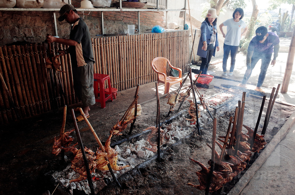 Row of chicken getting grilled during a BBQ, Vietnam, Southeast Asia