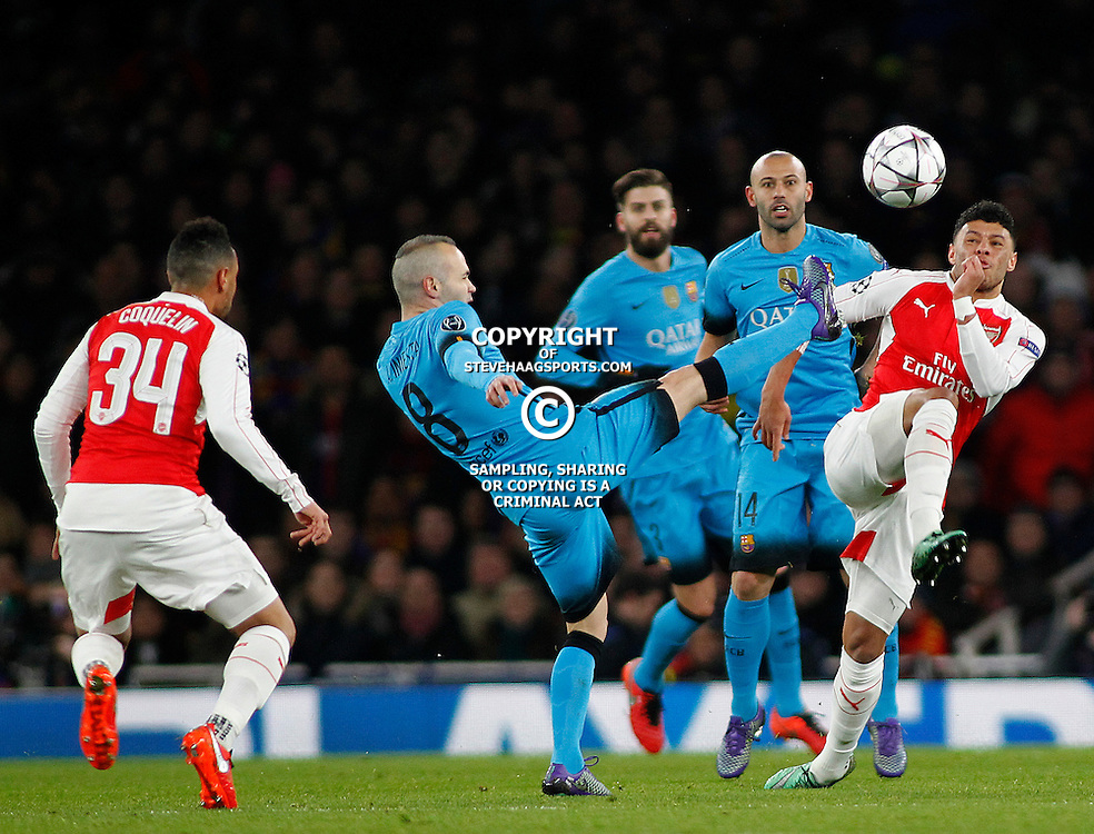 LONDON, ENGLAND - FEBRUARY 23: Andres Iniesta of Barcelona and Alex Oxlade-Chamberlain of Arsenal compete for the ball during the Champions League match between Arsenal and Barcelona at The Emirates Stadium on February 23, 2016 in London, United Kingdom. (Photo by Mitchell Gunn/ESPA-Images)