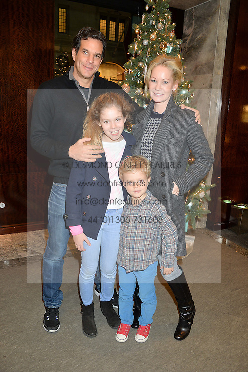 BRENT & GENEVIEVE HOBERMAN with their children MONTY & JADE at a VIP evening hosted by Joely Richardson at the Tiffany & Co Christmas Shop, Tiffany & Co Old Bond Street, London on 24th November 2013.