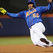 NEW YORK, NEW YORK - APRIL 11: Yoenis Cespedes, New York Mets, slides into third base during the Miami Marlins Vs New York Mets MLB regular season ball game at Citi Field on April 11, 2016 in New York City. (Photo by Tim Clayton/Corbis via Getty Images)