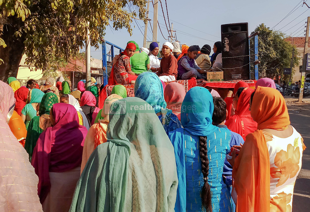 November 21, 2018 - Chandigarh, Punjab, India - Indian Sikh devotees are seen participating during the Nagar Keertan (Holy Procession) in Chandigarh..A religious procession was held in the region ahead of the birth anniversary of Guru Nanak Dev, the founder of the Sikh faith, which will be celebrated across the country on November 23. (Credit Image: © Saqib Majeed/SOPA Images via ZUMA Wire)