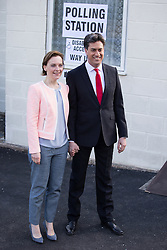 © Licensed to London News Pictures . 07/05/2015 . Doncaster , UK . Labour leader Ed Miliband and his wife Justine Thornton leave Sutton Village Hall polling station in Doncaster North after voting at the general election . Photo credit : Joel Goodman/LNP